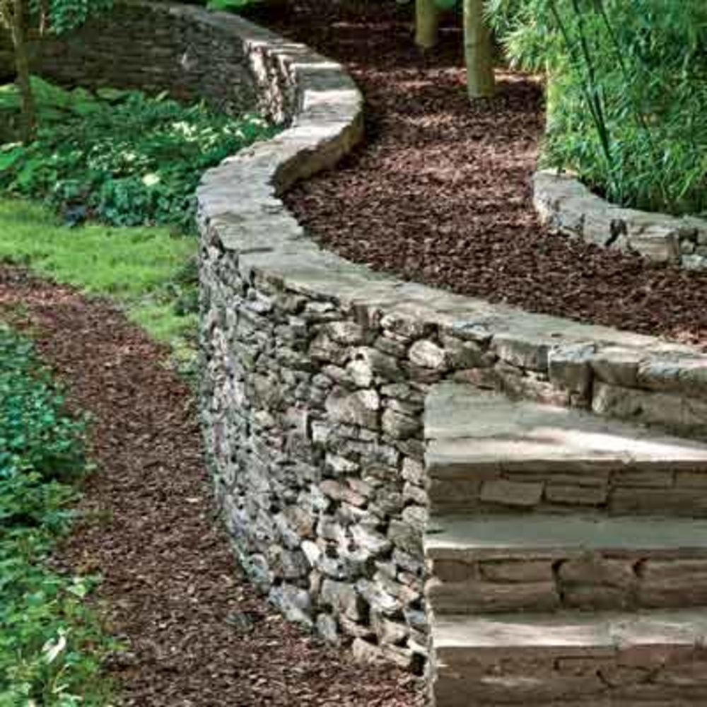 Bag Of River Stone : How to build a retaining walls denbok landscaping design
